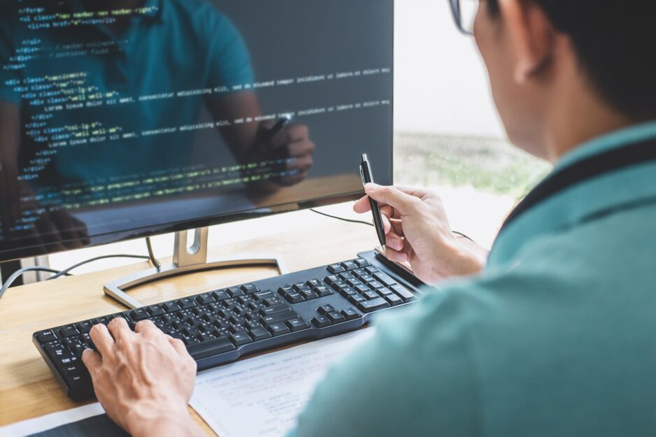 Young Professional programmer working at developing programming and website working in a software